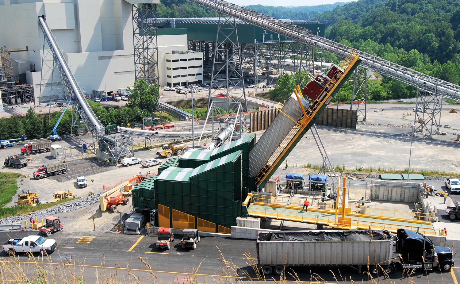 A wood tipper delivers wood waste to the Virginia City circulating fluidized bed plant, which can burn up to 20 percent biomass along with coal.
